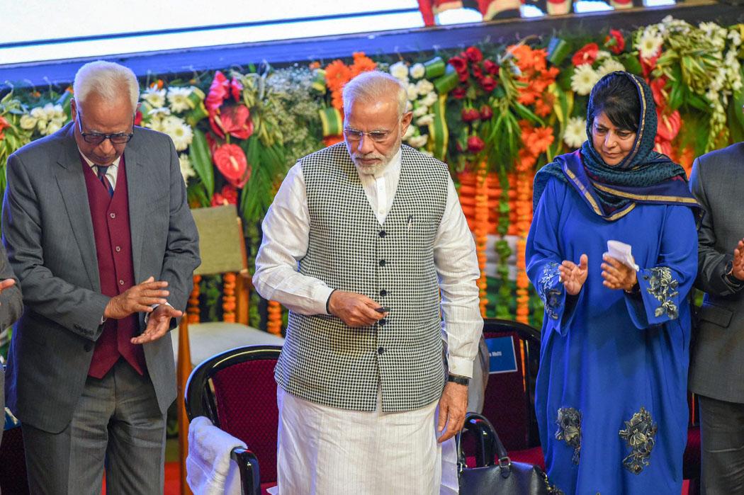 Prime Minister Narendra Modi flanked by J&K Governor NN Vohra